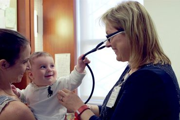 Baby pulling stethoscope. Photo courtesy Mount Sinai Parenting Center