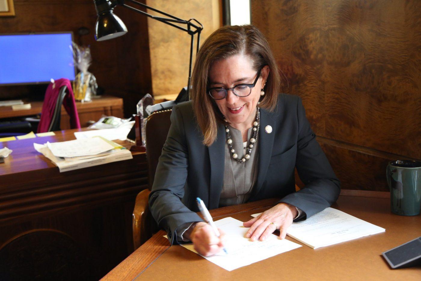 Gov Kate Brown of Oregon signs legislation for education funding into law