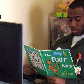 Mr. Johnson reading Dr. Seuss to his kids via video